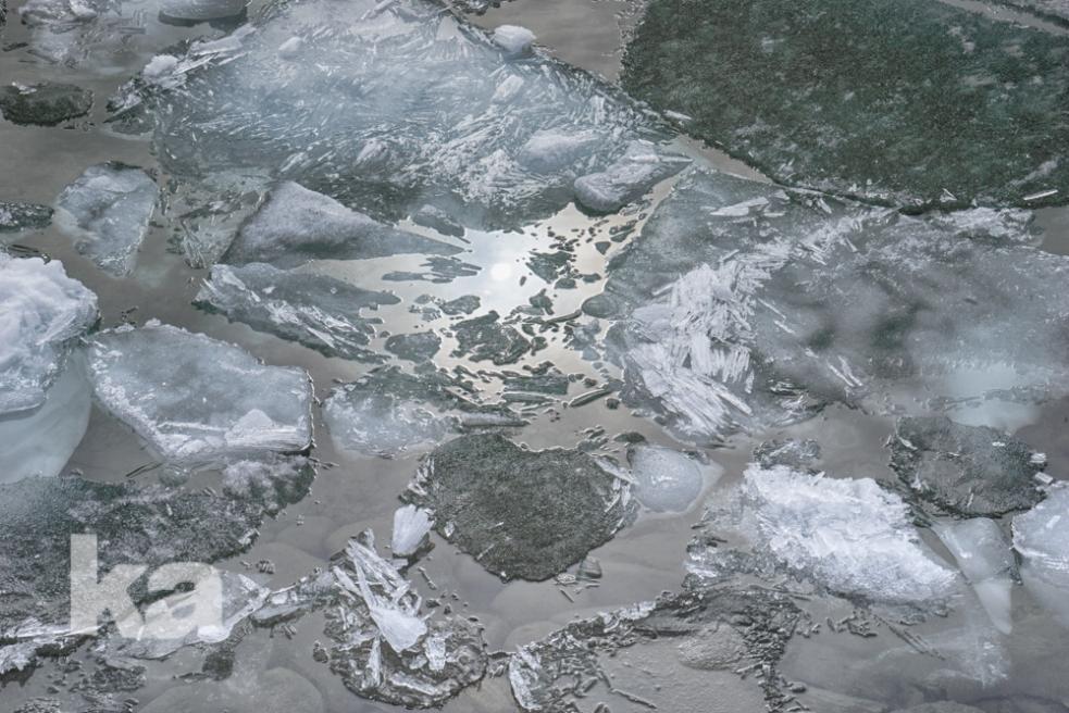 sun reflected in ice break up