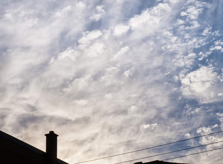 clouds over smokestack