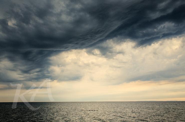 ducks under billowy clouds